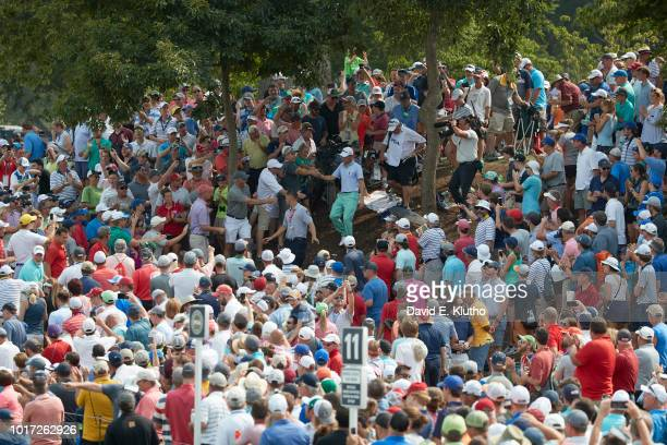 PGA Championship View of Justin Thomas after attending to spectator who was struck by his ball in gallery during Sunday play at Bellerive CC Sequence...