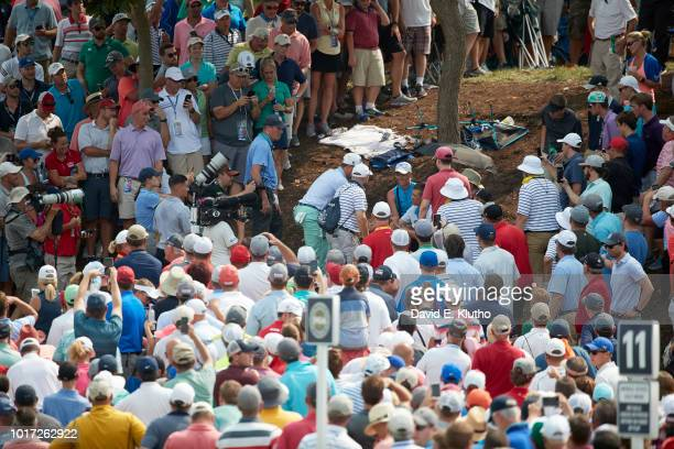 PGA Championship View of Justin Thomas attending to spectator who was struck by his ball in gallery during Sunday play at Bellerive CC Sequence St...