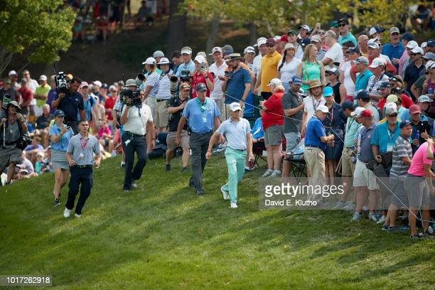 PGA Championship View of Justin Thomas walking to spectator who was struck by his ball in gallery during Sunday play at Bellerive CC Sequence St...