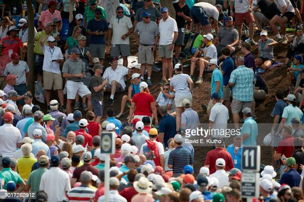 PGA Championship View of spectator receiving attention after being struck by ball in gallery during Sunday play at Bellerive CC Sequence St Louis MO...