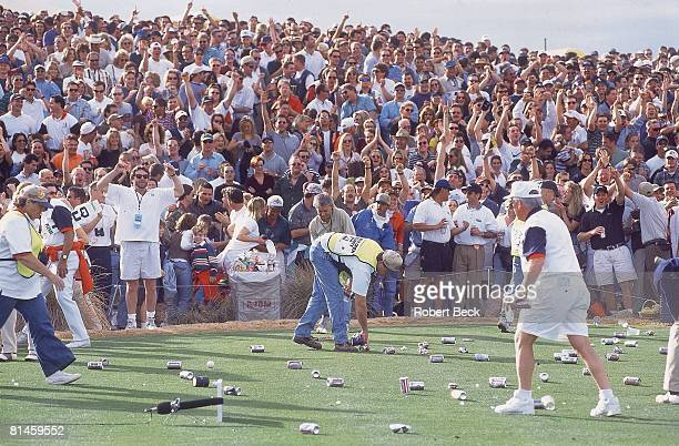 Golf Phoenix Open Fans throw beer cans on the tee after Tiger Woods holeinone on Saturday Phoenix AZ 1/25/1997