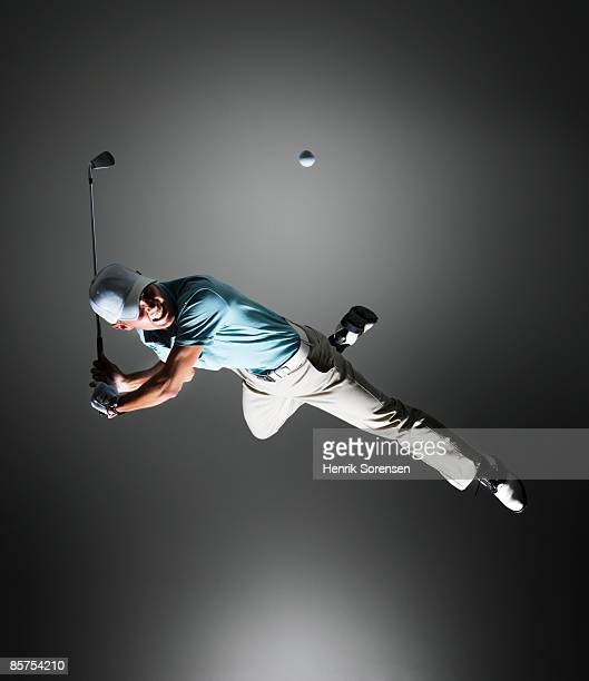 Golf player hanging in the air.