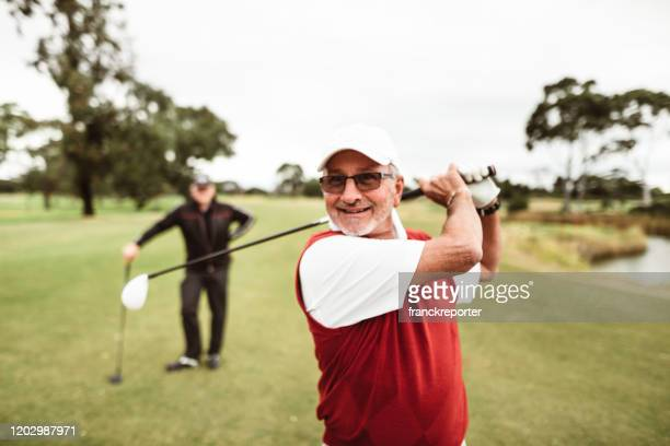 golf player hitting the ball - golf tournament stock pictures, royalty-free photos & images