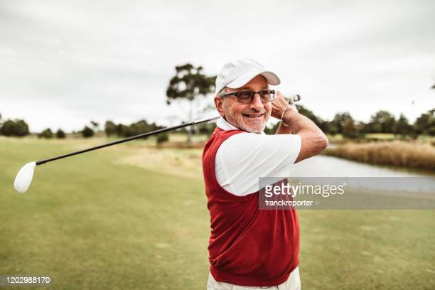 golf player hitting the ball - golf stock pictures, royalty-free photos & images