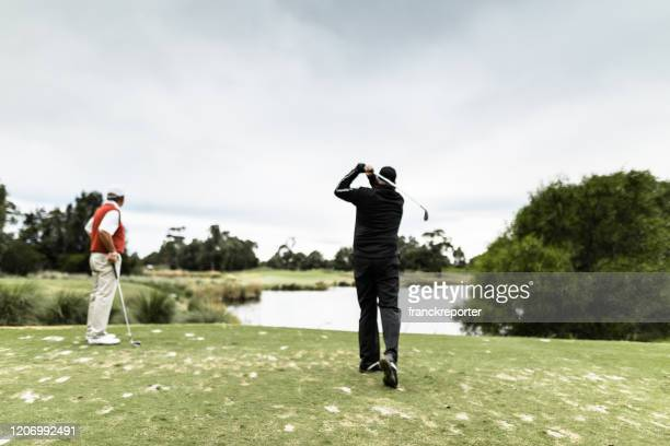 golf player hitting the ball - victoria australia stock pictures, royalty-free photos & images