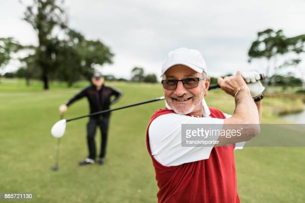 golf player hitting the ball - golfer stock pictures, royalty-free photos & images