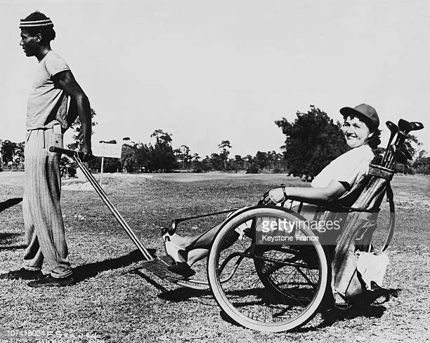 Golf Player In A Wheelchair Push By Black Man In Michigan In Usa On February 1946
