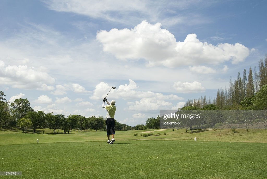 Golf player in action in tropical golf course in Thailand : Stock Photo