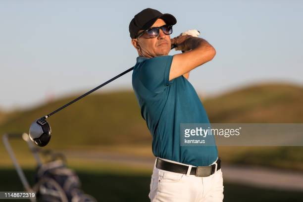golf player looking after shoting ball -  links golf - meter unit of length stock pictures, royalty-free photos & images
