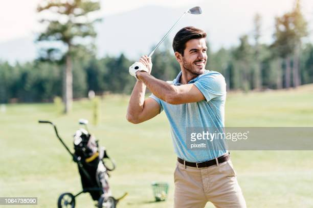 golf player - golf swing stock pictures, royalty-free photos & images