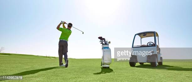 golf player - alternative fuel vehicle stock pictures, royalty-free photos & images