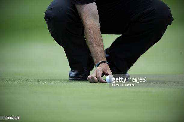 A golf player puts the ball to play on the 18th hole during the second round of the Estoril Open Portugal at the Penha Longa Golf Club on June 11 in...