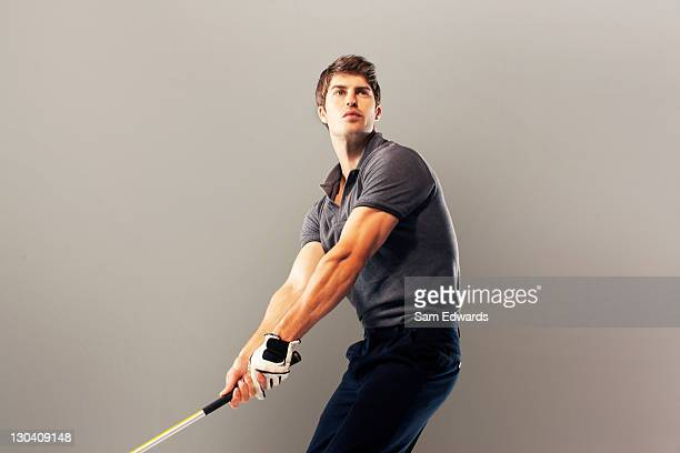 golf player ready to swing club - golfer stock pictures, royalty-free photos & images