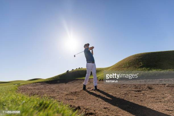 golf player shoting ball - links golf - meter unit of length stock pictures, royalty-free photos & images