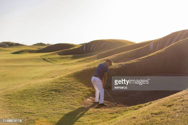golf player shoting ball - links golf - golf flag stock pictures, royalty-free photos & images