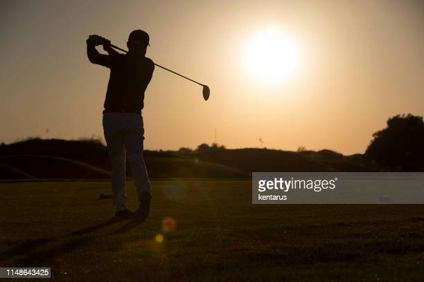 golf player shoting ball - sunset time -  links golf - meter unit of length stock pictures, royalty-free photos & images