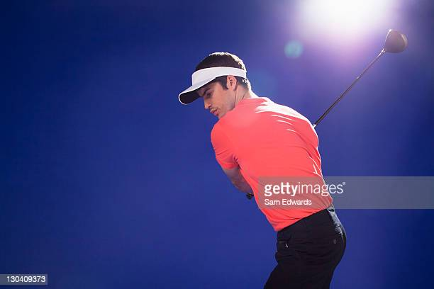 golf player swinging club - sam's club stock pictures, royalty-free photos & images
