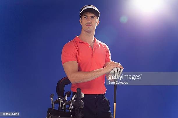 golf player with club and golf bag - sam's club stock pictures, royalty-free photos & images