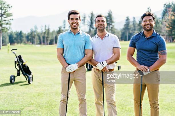 golf players side by side - khaki trousers stock pictures, royalty-free photos & images