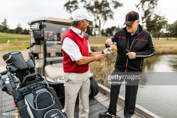 golf players take a break at the golf course - golf tournament stock pictures, royalty-free photos & images