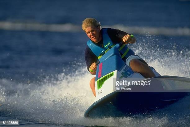 Golf Portrait of John Daly jet skiing on lake at home Orlando FL 5/13/1993