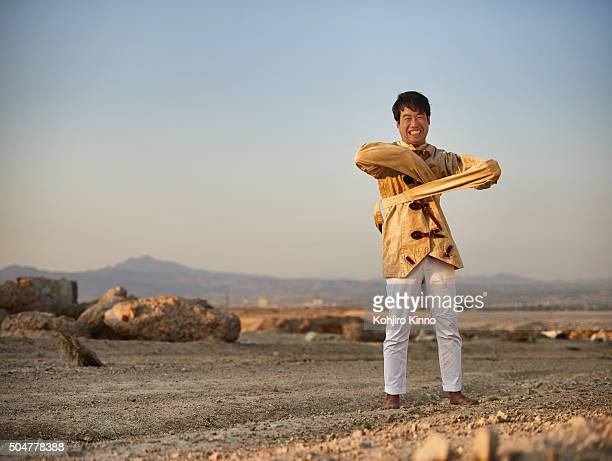 Portrait of Kevin Na wearing straitjacket during photo shoot in the desert outside of Las Vegas Clark County NV CREDIT Kohjiro Kinno