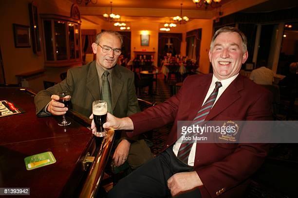 Golf Portrait of SI senior writer John Garrity and Carne Golf Links secretary/manager John O'Hara at pub Belmullet Ireland 7/29/2003
