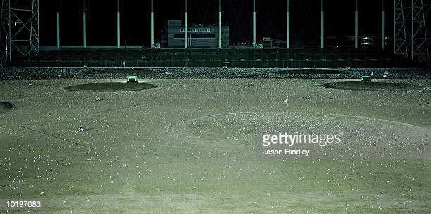 golf practice range illuminated at night - driving range stock photos and pictures
