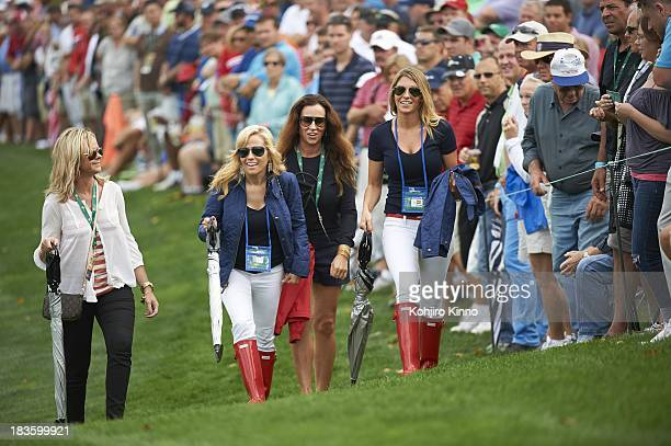 Presidents Cup Amy Mickelson wife of Phil Mickelson with Jillian Stacey girlfiriend of Keegan Bradley follow the play during Thursday Fourball...