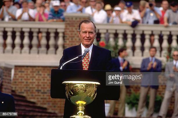 Former United States President George H.W. Bush with Presidents Cup trophy during award ceremony at Robert Trent Jones GC. Gainesville, VA 9/15/1996...