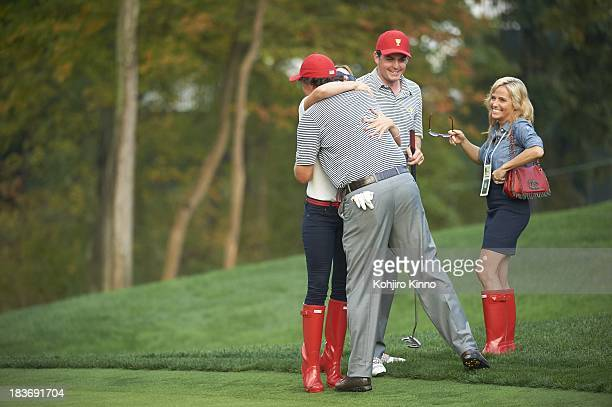 Presidents Cup Team USA Phil Mickelson with his wife Amy Mickelson and Keegan Bradley with his girlfriend Jillian Stacey during Friday Foursomes...