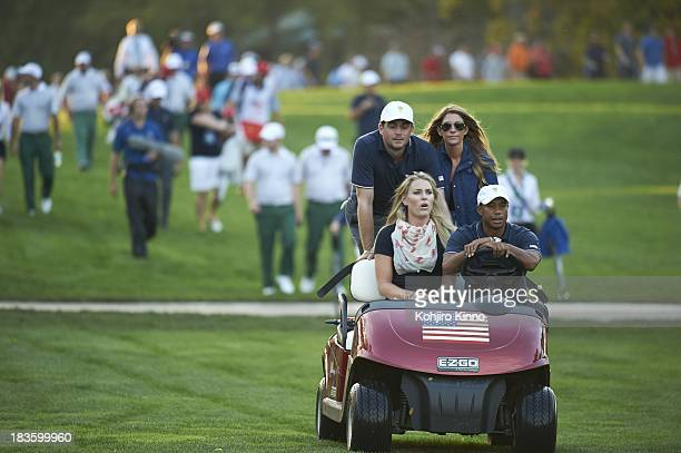 Presidents Cup Tiger Woods riding with girlfirend Lindsey Vonn Keegan Bradley and his girlfriend Jillian Stacey in golf cart during Thursday Fourball...