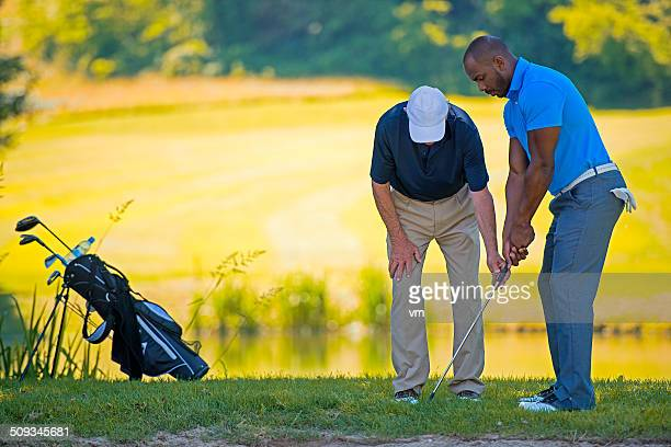 golf pro teaching male golfer - driving range stock pictures, royalty-free photos & images