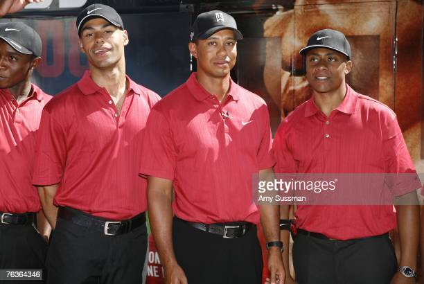 Golf Pro Tiger Woods with Tiger Woods lookalikes at the launch of Tiger Woods PGA Tour 08 on XBOX 360 at the Chelsea Piers on August 28 2007 in New...