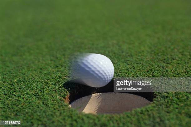 golf putt dropping in