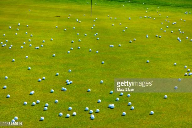 golf putting green with many golf balls - practicing stock pictures, royalty-free photos & images