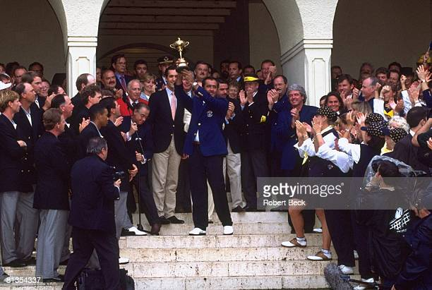 Golf Ryder Cup Europe captain Seve Ballesteros and Colin Montgomerie victorious with trophy after winning tournament vs USA on Sunday at Valderrama...