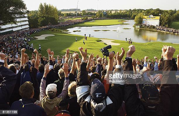 Golf: Ryder Cup, Europe fans victorious after Ireland Paul McGinley made winning putt during Sunday Singles matches on No Scenic view of leader board...