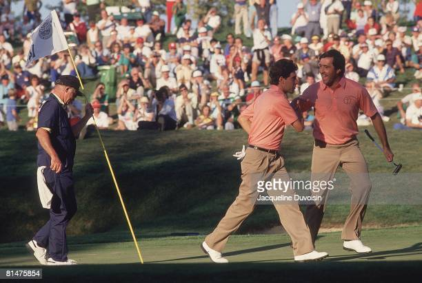 Golf Ryder Cup Europe Jose Maria Olazabal and Seve Ballesteros after making shot on No 14 during Saturday play at Muirfield Village GC Dublin OH...