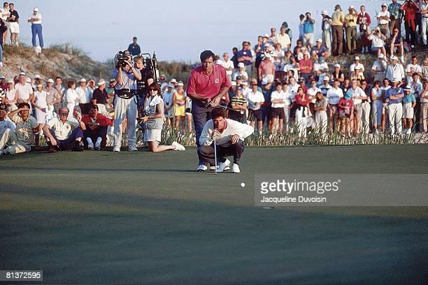 Golf Ryder Cup Europe Jose Maria Olazabal lining up putt with Seve Ballesteros during Saturday play at Kiawah Island Golf Resort Johns Island SC...