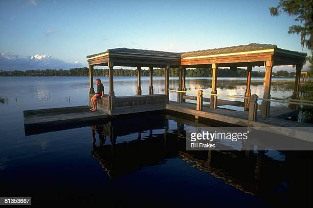 Golf Scenic portrait of John Daly on lake dock at home Orlando FL 5/13/1993