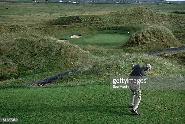 Golf Scenic rear view of SI Senior Writer John Garrity in action at Carne Golf Links Belmullet Ireland 7/29/2003
