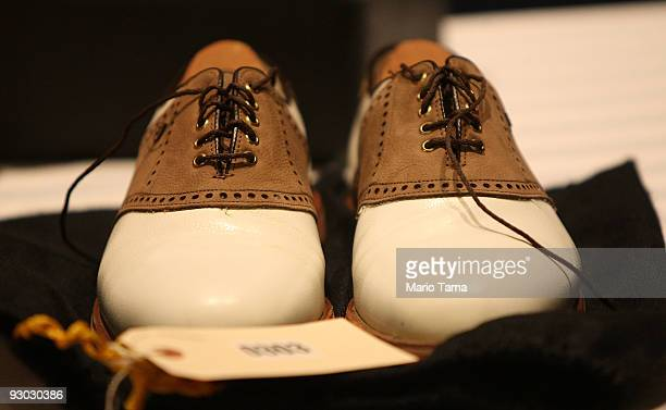 Golf shoes are displayed during a press preview of a US Marshals Service auction of personal property seized from Bernard and Ruth Madoff November 13...