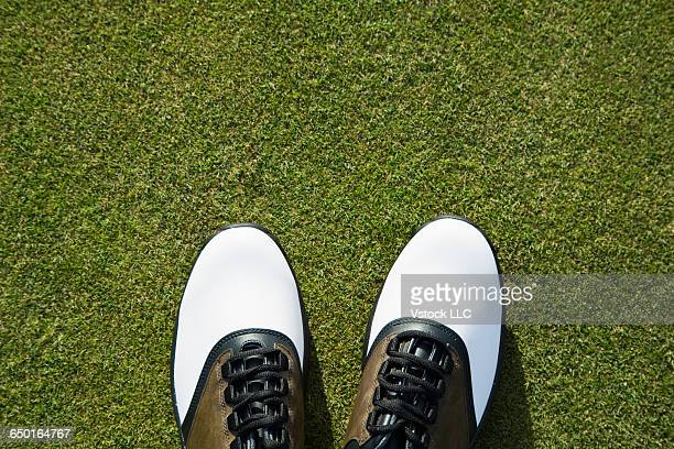 Golf shoes on grass