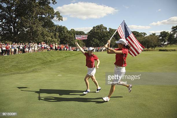 Solheim Cup USA Michelle Wie and Morgan Pressel victorious with American flags during single matches during Sunday play at Rich Harvest Farms Sugar...