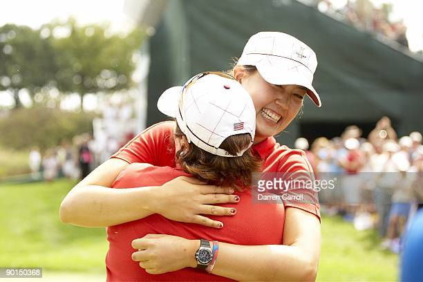 Solheim Cup USA Michelle Wie victorious hugging teammate during single matches during Sunday play at Rich Harvest Farms Sugar Grove IL 8/23/2009...