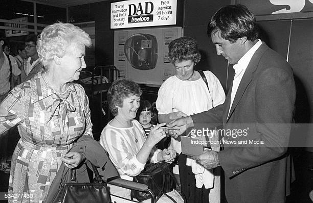 Golf Superstar Seve Ballesteros signs an autograph for Mrs Philomena Owen when he arrived at Dublin Airport for the Carroll's Irish Open at Royal...