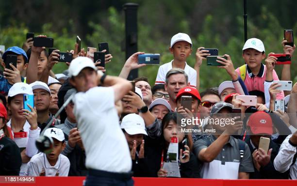 Golf supporters watch Rory McIlroy of Northern Ireland tee off on the 1st hole during the final day of the WGC HSBC Champions at Sheshan...