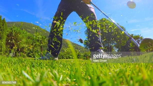 golf swing on the grass - チップする ストックフォトと画像
