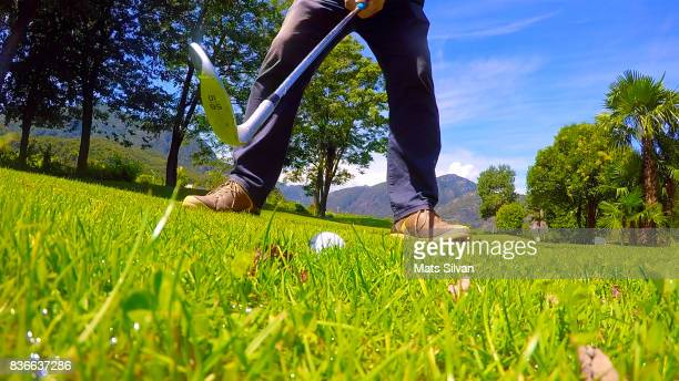 golf swing on the grass - chip shot stock pictures, royalty-free photos & images